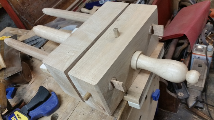 The almost completed bookbinder's plough. Oak pegs and wedges secure the rails and lock the handscrew in place.