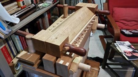 A modern book press sitting atop a 16th century style press